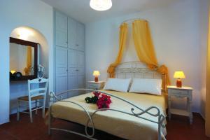 Ένα ή περισσότερα κρεβάτια σε δωμάτιο στο Belvedere Apartments