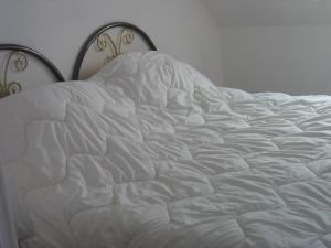 Un ou plusieurs lits dans un hébergement de l'établissement Holiday Home Gite de l'épine