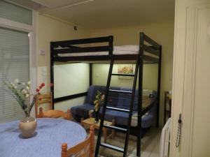 Un ou plusieurs lits superposés dans un hébergement de l'établissement Holiday Home Gite de l'épine