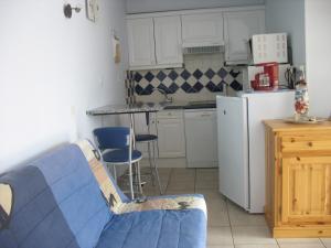 Cuisine ou kitchenette dans l'établissement Holiday Home Gite de l'épine