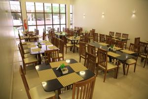 A restaurant or other place to eat at Stay Inn Hotel