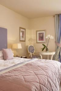 A bed or beds in a room at Skiathos Princess