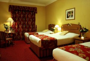 A bed or beds in a room at Clonakilty Park Hotel