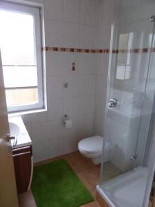 Ein Badezimmer in der Unterkunft Haus am Fluss