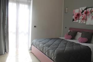 Łóżko lub łóżka w pokoju w obiekcie B&B Vesuvio Smiling