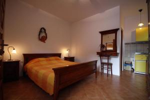 A bed or beds in a room at Apartments Savina