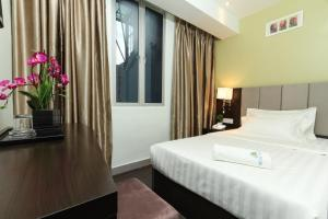 A bed or beds in a room at Amigo Hotel