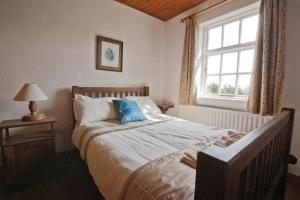 A bed or beds in a room at Cottage 135 - Oughterard