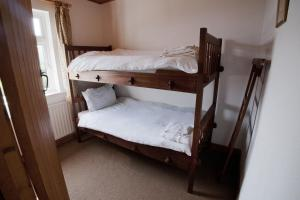 A bunk bed or bunk beds in a room at Cottage 135 - Oughterard