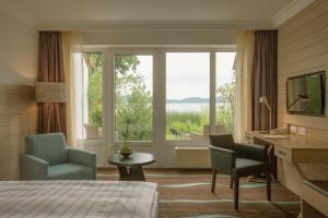 Ein Sitzbereich in der Unterkunft Hotel Der Seehof