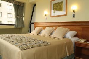Cama o camas de una habitación en Gala Hotel