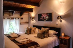 A bed or beds in a room at Invergloy Riverside Lodges