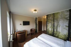 Ein Bett oder Betten in einem Zimmer der Unterkunft Wildeshauser Hof Hotel Huntetal