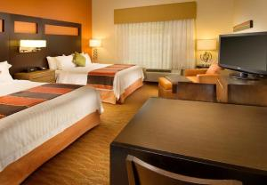 A television and/or entertainment center at TownePlace Suites by Marriott San Antonio Downtown