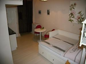 Postel nebo postele na pokoji v ubytování Apartment Helena