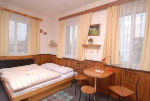A bed or beds in a room at Horský Hotel Arnika