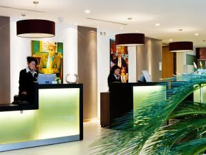The lobby or reception area at Louis Fitzgerald Hotel