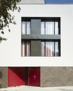The facade or entrance of The Urban Suites