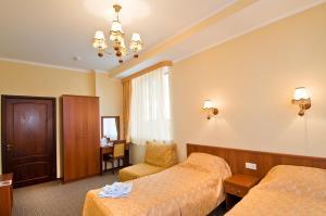 Кровать или кровати в номере Отель Партнер