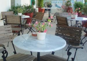 A porch or other outdoor area at Orfeas Hotel