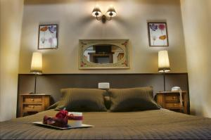 Cama o camas de una habitación en Hostal Alfonso XII