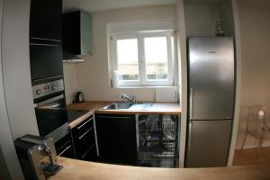 A kitchen or kitchenette at Appartement Le Sleidan