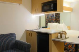 A bathroom at Microtel Inn & Suites-Conyers