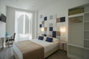Uma cama ou camas num quarto em Thomar Story - Guest House
