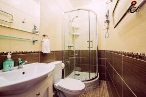 Ванная комната в Апарт-Отель Пушкарев