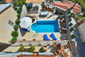 A view of the pool at Vasilikis House or nearby