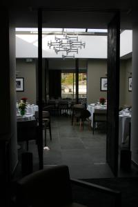 Restaurant ou autre lieu de restauration dans l'établissement Hotel Blanc
