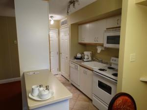 A kitchen or kitchenette at Suites at Jockey Club (No Resort Fee)