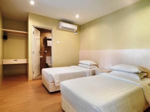 Katil atau katil-katil dalam bilik di Fenix Inn