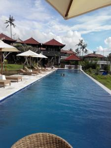 The swimming pool at or near Gubug Balian Beach Bungalow