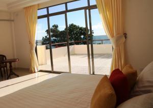 Emerald Hotel & Restaurantにあるベッド