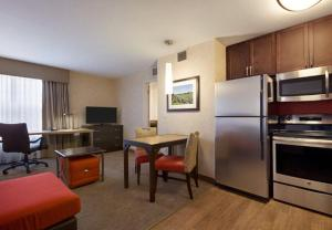A television and/or entertainment center at Residence Inn by Marriott Long Island Islip/Courthouse Complex