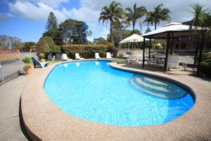 The swimming pool at or near Bella Villa Motor Inn