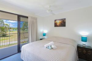 A bed or beds in a room at Regency Waterfront Noosa