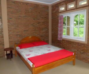 A bed or beds in a room at Efata Homestay