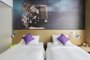 A bed or beds in a room at Ibis Styles Ambassador Seoul Myeong-dong
