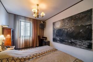 Кровать или кровати в номере Гостиница Шкиперская