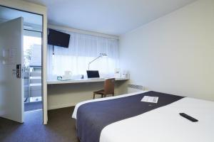 Een bed of bedden in een kamer bij Campanile Lille Sud - CHR