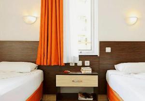 Ett badrum på Ada-1 Apart Hotel