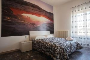 A bed or beds in a room at La Formica B&B