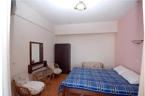 A bed or beds in a room at Porto Kalliali