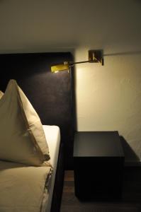 Ein Sitzbereich in der Unterkunft Hotel Löwen