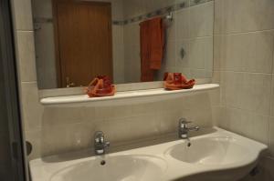 Ein Badezimmer in der Unterkunft Hotel Löwen