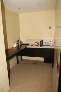 A kitchen or kitchenette at Urgoo hotel