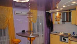 A kitchen or kitchenette at Buro Skazka Apartments