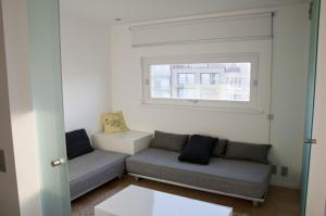 Coin salon dans l'établissement Apartment Schopenhauer